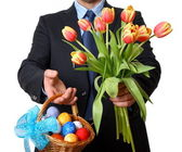 Man in suit and tie gives tulips and Easter basket — Stock Photo