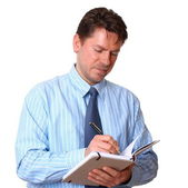 Satisfied Employee writes notes in notebook — Stock Photo