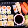 Exclusive sushi menu in your Delivery closeup - Stock Photo