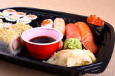 Exclusive sushi menu in your Delivery — Stock Photo