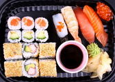 Exclusive sushi menu in your Delivery closeup — Stock Photo