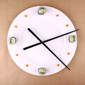 Clock Concept with sushi on white plate — Stock Photo