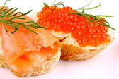 Salmon Red caviar on bread with dill — Stock Photo