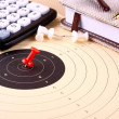 Hit the target - target, red pin, calculator, pen, notebook — Stock Photo