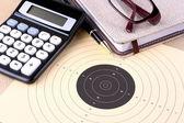 Target, calculator, pen, notebook, glasses - setting goals — Stock Photo