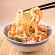 Rice noodle with chicken meat and chopsticks, top view — Foto Stock