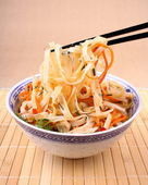 Rice noodle with chicken meat and chopsticks, top view — Stock Photo