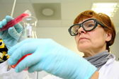 Mature woman as a research assistant in laboratory — Stock Photo