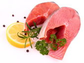 Salmon steaks with lemon and spices — Stock Photo