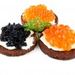 Pumpernickel bread with red and black caviar — Stock Photo