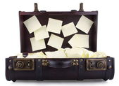 Open old suitcase with yellow notepad — Stock Photo
