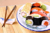 Sushi with red caviar and chopsticks — Stock Photo