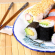 Stock Photo: Sushi variations with chopsticks and red caviar