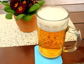 Liter of beer at the table in beer garden — Stock Photo