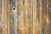Eski ahşap tahta delikleri ile arka plan olarak — Stok fotoğraf