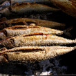 Grilled fish (Steckerlfisch) at Munich Oktoberfest - Stock Photo
