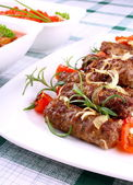 Grilled meat rolls with giant white beans and sauce — Stock Photo
