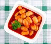 Giant white beans in tomato sauce — Stock Photo