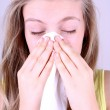 Girl blows her nose with handkerchief, allergy concept — Stock Photo #25459875