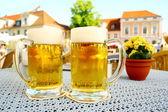 Two steins beer garden in the city — Stock Photo