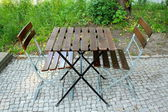 Two chairs and table in beer garden — Stock Photo