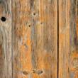Stock Photo: Old wooden board with holes as background