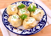 Manti, dumplings with minced meat and cream — Stock Photo