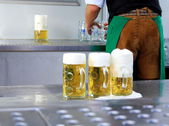 Fresh draft three liters beer at Oktoberfest and worker — Stock Photo