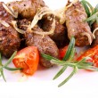 Grilled meat rolls with tomato and rosemary — Stock Photo