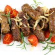 Grilled meat rolls with tomato and rosemary, close up — Stock Photo