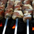 Marinated, raw lamb meat grilling on metal skewer — Stock Photo