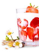 Ripe strawberries with white yogurt in glass, flowers and cereal — Stock Photo