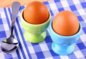 Two boiled eggs with spoon — Stock Photo