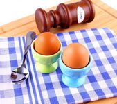 Two boiled eggs with spoon and salt — Stock Photo