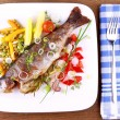 Stock Photo: Grilled trout with quite different vegetables with cutlery