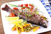 Grilled trout with quite different vegetables with cutlery — Stock Photo