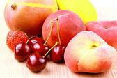 Cherries, platt peach, strawberries, lemon and mango, close up — Stock Photo