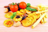 Mediterrean snack, pizza crackers, dried olives, nuts, tomatoes — Stock Photo