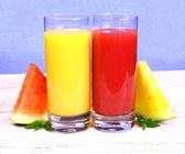 Red and yellow watermelon with juice and mint, close up — Stock Photo