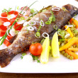 Stock Photo: Grilled trout and quite fine vegetables with cutlery