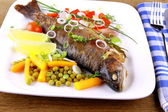 Grilled trout with quite fine vegetables, cutlery — Stock Photo