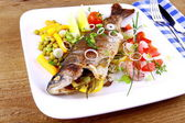 Grilled trout with quite fine vegetables and cutlery — Stock Photo
