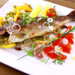 Grilled trout with quite fine vegetables on wood background — Stock Photo