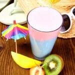 Cocktail, strawberry, mango and kiwi, with holiday background — Stock Photo #28901411