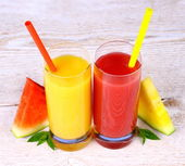 Red and yellow watermelon, juice with straw — Stock Photo