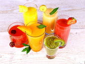 Fruit juices, kiwi, cherry, orange, strawberry, banana, pineapple — Stock Photo