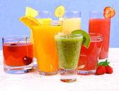 Fruit juices, kiwi, raspberries, cherry, orange, strawberry, pineapple — Stock Photo