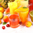 Fruits juice with cherry, apricot, kiwi, watermelon and orange — Stock Photo