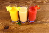 Pineapple, banana and strawberry juice in glass — Stock Photo