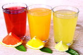 Citrus juices in glass - grapefruit, oranges and lime — Stock Photo